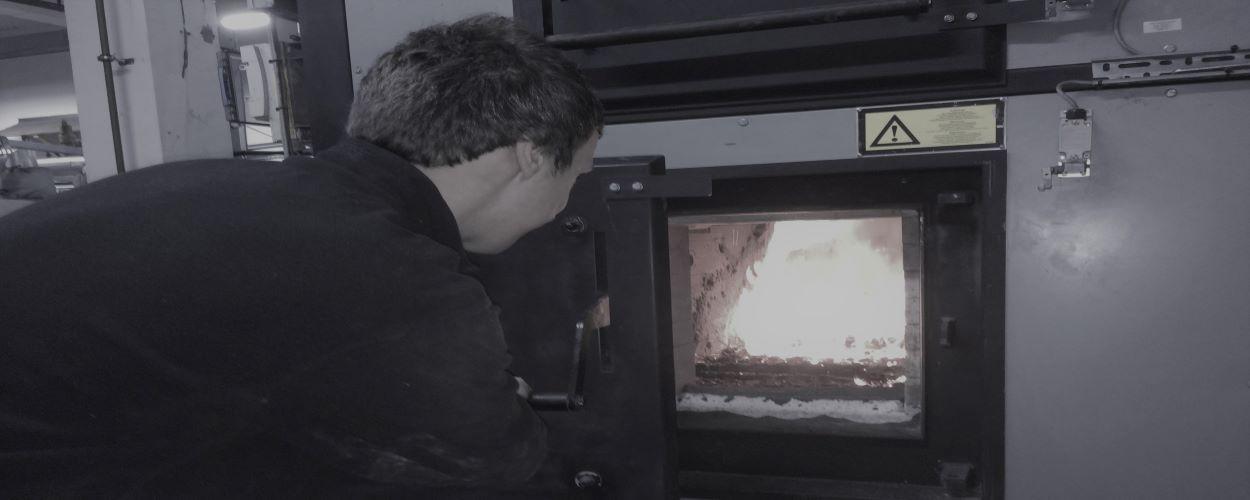NerG Engineer looking into burn chamber